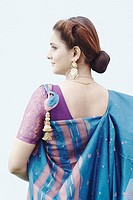 Rear view of a young woman wearing a sari