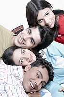 Close-up of two young men and two young women smiling