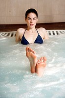 Young woman in jacuzzi at a spa (thumbnail)