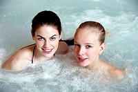 Two young woman in jacuzzi at a spa