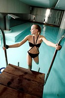 Young woman in a swimming pool at a spa (thumbnail)