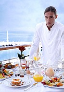 Waiter with breakfast table