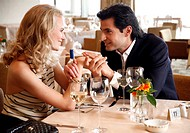 Couple having a romantic moment in a restaurant