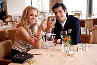 Couple drinking wine in a restaurant (thumbnail)