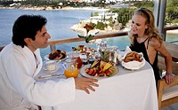 Couple having breakfast on hotel terrace (thumbnail)