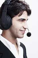 Close-up of a young man wearing a headset