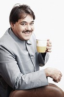 Portrait of a businessman holding a cup of tea