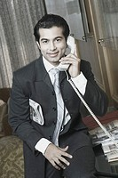 Portrait of a businessman talking on the telephone