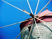 Windmill at Mandraki Harbor, old town of Rhodes, Greece