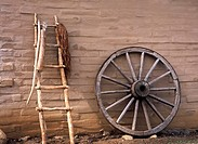 Ladder and wheel leaning against the wall