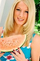 Woman holding a water-melon.
