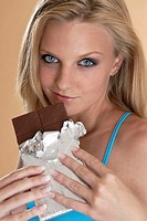 Woman holding a chocolate bar (thumbnail)