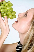 Woman holding green grapes