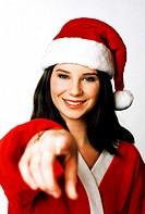 Woman in santa suit pointing at the camera.