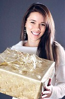 Woman holding a big box of present