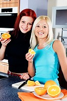 Women eating oranges