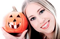 Woman holding a carved pumpkin