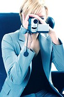 Businesswoman taking video with a video camcorder