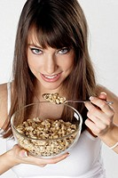 Woman eating breakfast cereal.