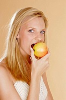 Woman biting an apple.