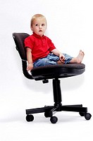 Boy sitting on an office chair