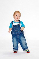 Boy wearing bib overall