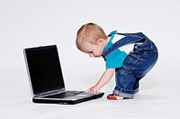 Boy playing with laptop