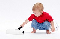 Boy playing with paint roller
