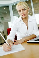 Businesswoman busy writing report