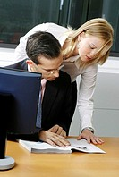 Businessman having discussion with her assistant