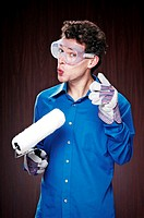 Man with goggles holding a paint roller