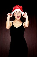 Woman wearing christmas hat