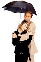 Loving couple sharing an umbrella