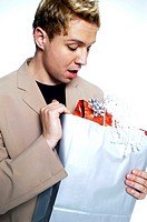 Man trying to open his present