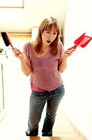 Woman holding brush and dustpan