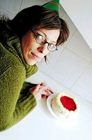 Woman pointing at a cake