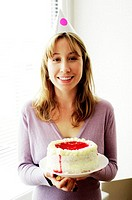 Woman holding a cake