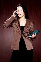 Businesswoman answering call.