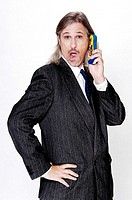 Businessman talking on a toy mobile phone