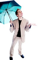 Businessman holding an umbrella while checking the weather