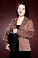 Businesswoman holding a briefcase.