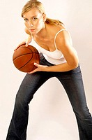Woman playing basketball