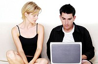 Couple sharing a laptop