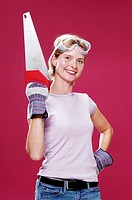 Woman with goggles holding a saw