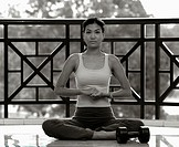 Woman in fitness wear meditating.