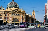 Trams passing Flinders Street Station in Melbourne. Victoria. Australia