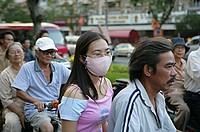 People on motobike on Nguyen Hue St,  Ho Chi Minh City, Vietnam