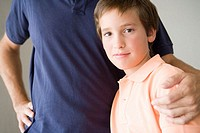 Son with father's hand on shoulder