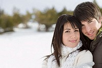 Smiling couple on winter vacation