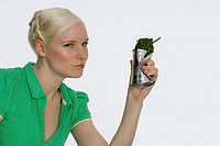 Young woman holding a can of spinach